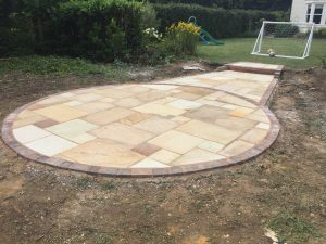 Decorative patio using Natural Indian Stone Paving. Felsted, Essex