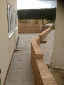 Retaining walls and Indian sandstone paving. Little Hadham, Herts