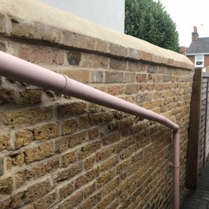 Garden wall restored using reclaimed yellow stocks bricks and lime mortar Bishop's Stortford, Herts