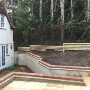 Existing retaining walls rendered with a brick on edge capping. Bishops Stortford, Herts